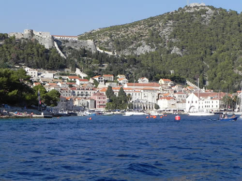 Approaching Hvar from the sea with Fortica and the Napolean fort above