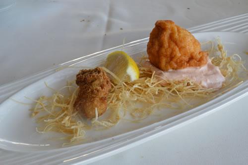 Souffle of calamari on cream of prawns