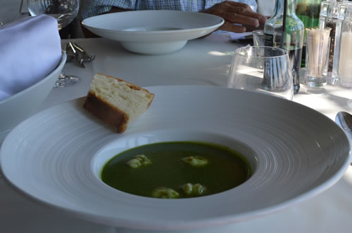Soup of broccoli and scampi
