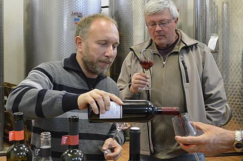 Leo Gracin pouring his wine