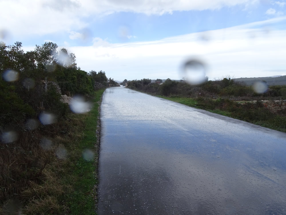 Sky reflected off the wet road